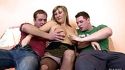 Curvy ass mature woman is being pumped in both holes by two younger lads