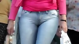 Woman playing with amazing ass wearing tight jeans