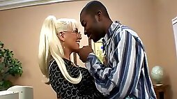 Milf gives head to big black cock