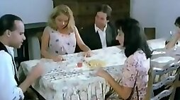 Hairy wet pussy licking and fingering under the table in this vintage video