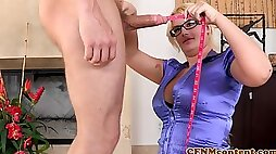 Clothed blonde measures cock sucking