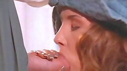 Foxy cowgirl gives an alluring blowjob in an epic retro clip