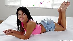 Fine brunette teen babe on the bed undresses and patiently sucks huge dick on POV tape