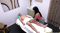 Spy web cam inwards of the Japanese softcore rubdown parlor
