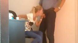 Romanian blonde secretary caught sucking her boss in the office