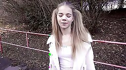 Teen girl with pigtails is treating a stranger with a POV blowjob in public