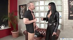 Adorable brunette in a leather attire has an entire jumbo cock sink in her pussy