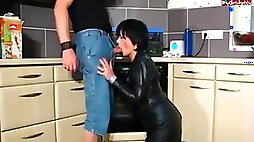 Hot cougar in leather boots gets it in kitchen